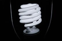 A close-up of an illuminated lightbulb