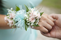 wrist corsage and holding hands