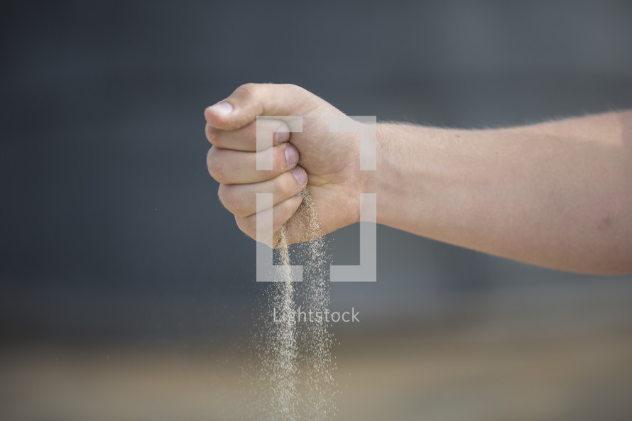 filtering sand in your hand