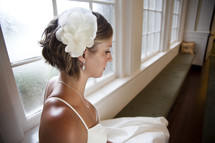 bride sitting on a window bench