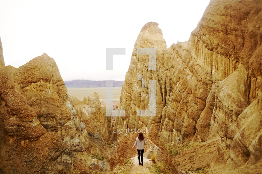 a woman surrounded by jagged mountain peaks