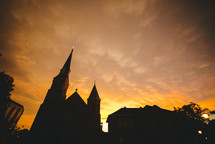 A church silhouetted at sunset