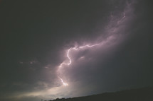 Lightening strike and storm clouds