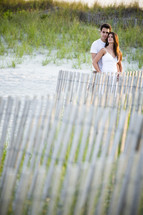 Couple standing on a beach