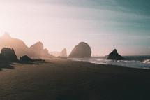 tide washing onto a beach at sunrise