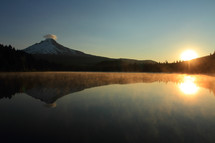 reflection in a lake of mount hood sunrise