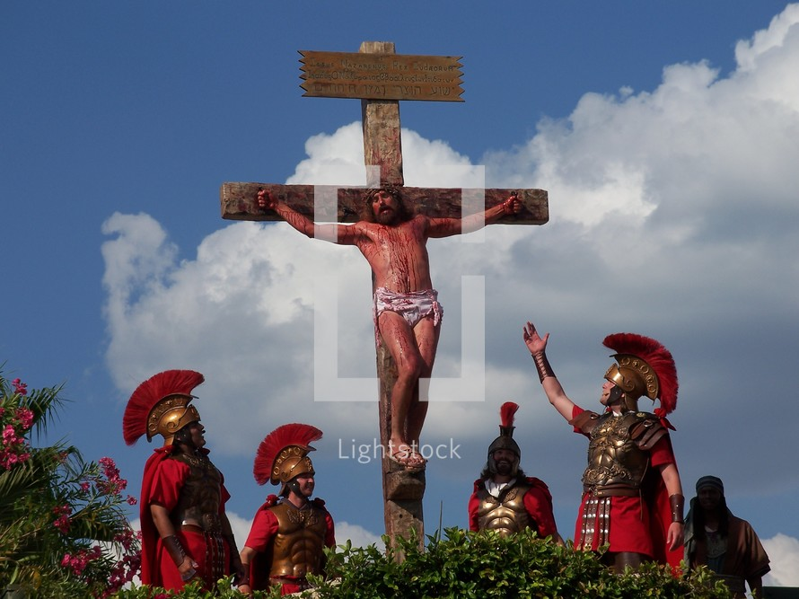 The crucifixion of Jesus - Roman soldiers stand by and mock Jesus as he dies on the cross of Calvary at Golgotha, known as the place of the skull.
