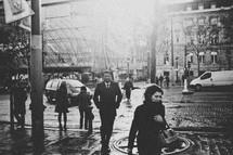 People walking across a busy street