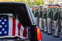 Highway patrol officers honoring fallen officer, casket, Hurst, American flag, honor, respect, risk, gratitude price for freedom