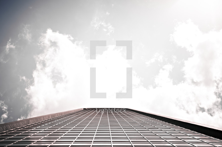A skyscraper stretches up to the clouds.