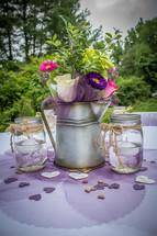 flower arrangement on a table at a wedding reception
