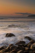 ocean tide washing onto rocks