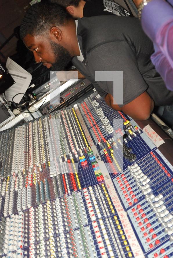 man in a control center at a sound board