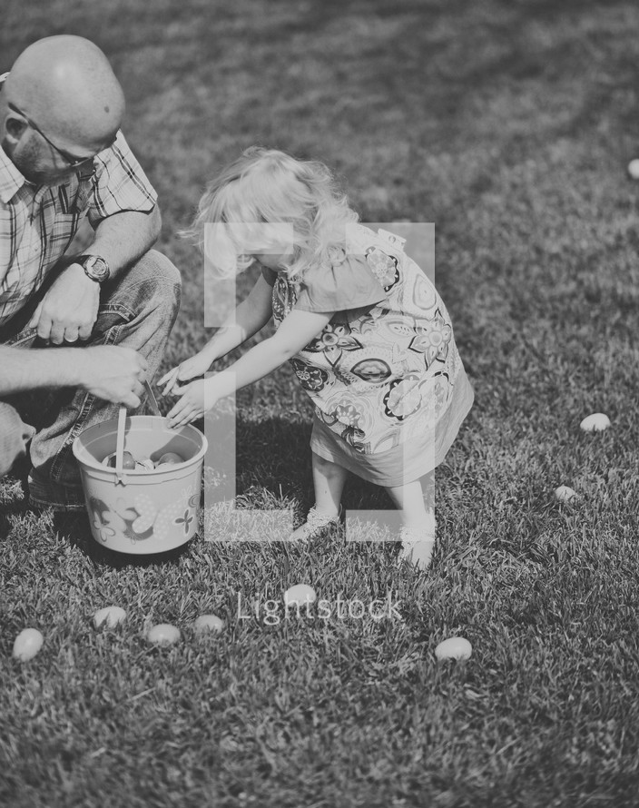 grandfather and granddaughter during an Easter Egg hunt