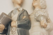 closeup of a bride and groom cake topper