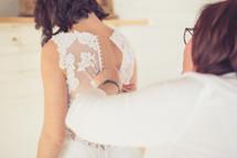 seamstress altering a wedding dress