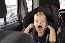 a toddler in a carseat