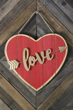 love heart sign on a wood background