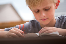 boy reading a Bible