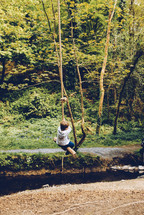 a child on a rope swing