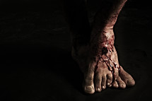The punctured feet of Jesus
