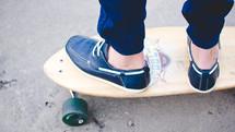 feet of a boy on a skateboard