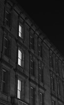 lights on in the windows of an apartment building