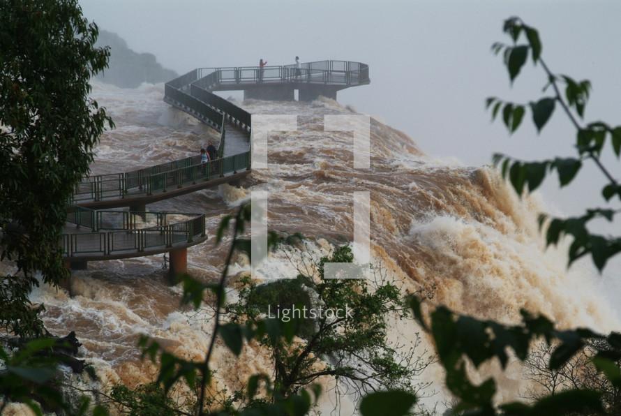 A walkway bridge on the edge of a Brazilian waterfall