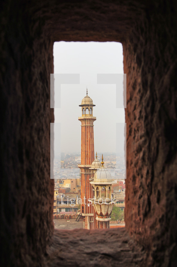 viewing towers of a mosque through a window