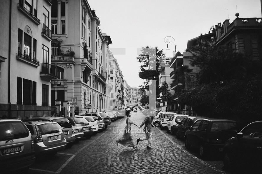 Couple running across street