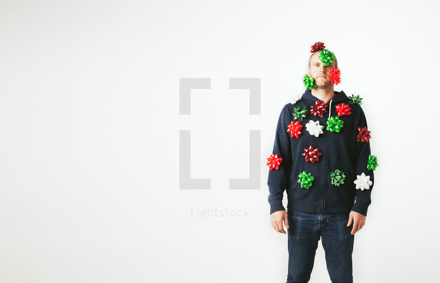 A man covered in Christmas bows