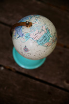 globe on old wood boards