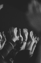 Raised hands at a worship service.