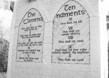 Ten Commandments carved in stone on stone tablets in a monument rendition of the original ten commandments that God gave to Moses in the book of Exodus for the Hebrew children to follow.
