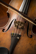 A vintage well used old violin and bow
