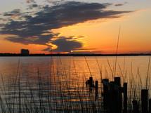 A lake lit by a sunset.