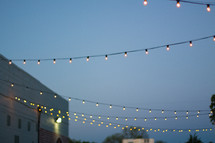 string of lights hanging over an alley