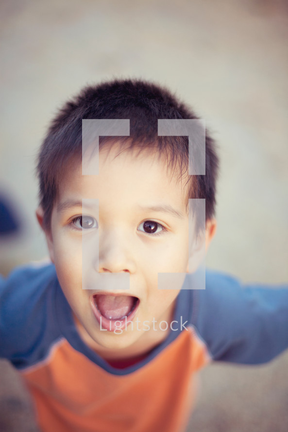 boy child with an open mouth