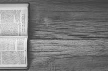 Sideways Bible opened to  2 Corinthians