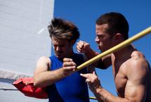 Men wrestling in match