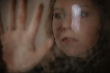 portrait of a woman through mirrored glass