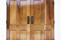 closed wooden doors.