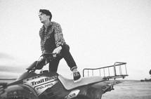 Male riding ATV