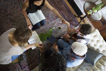 woman's group Bible study having a discussion and prayer in a living room