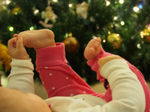 Baby in front of Christmas tree