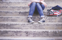 teenager waiting on steps