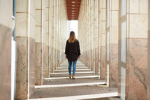 a woman standing in a corridor