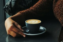 a woman with a latte