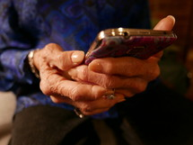 elderly woman holding a cellphone