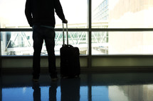 a man with luggage in an airport